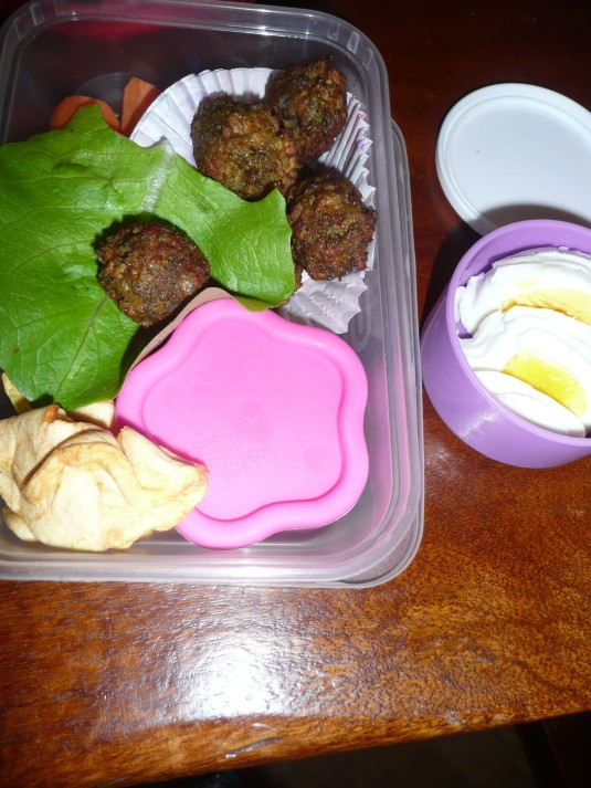 eggs, falafel, salad, carrot and apple